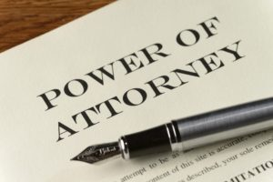 Legal document with Power Of Attorney printed at the top.
